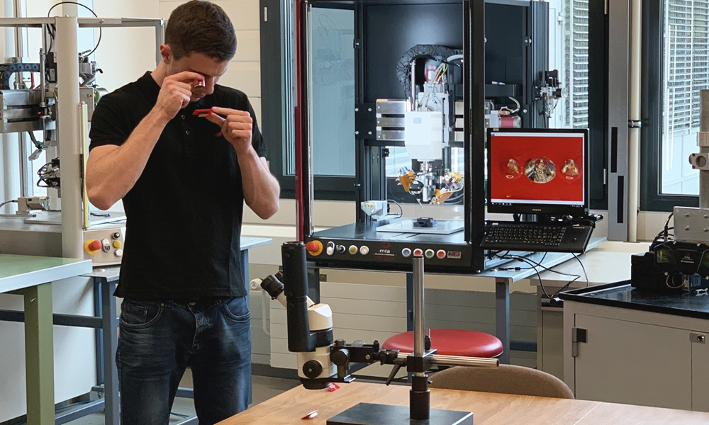 Technician working in soldering laboratory